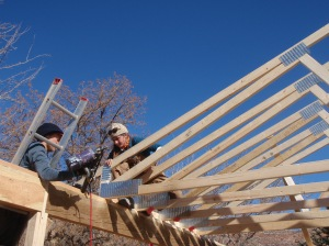 Kate and Austin secure a truss.