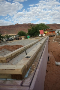 In this cockeyed image, you can see the borate treated baseboards we used.  Check out that CR house across the road!