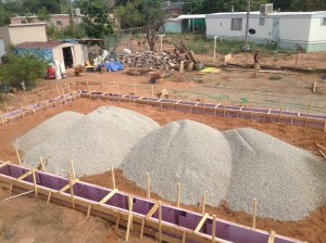 Massive mounds of gravel awaiting to be spread out