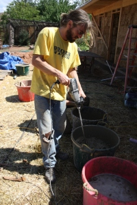 Here we have Jeff industrial egg-beatin' the water-clay mixture into a light slip to be added to the dry clay as fill for the hanging window and door frame lath baskets. The clay is locally sourced, just down the road. (Note: Jeff, your jeans are tearing.)