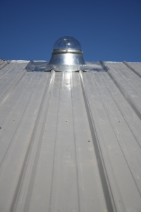 Here is a good example: a Solar Tube, or Tubular Lighting. Using an extremely reflective internal tube surface, the dome transports light into the home (in this case into the shower of the secondary bathroom) illuminating an otherwise darkened cavity of the house with natural light. Space age technology originally developed by Ancient Egyptians.