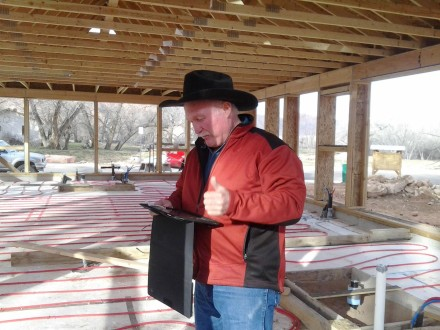 Building Inspector Jeff Whitney gives us the thumbs up! And while you're admiring his rad hat, take a look at that RADiant floor tubing...