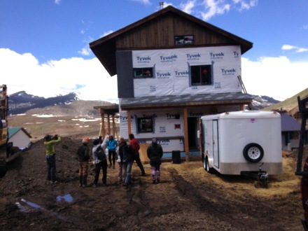 Outside the straw bale build with the team