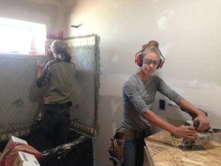 Homeowner Chad and Intern Claire prepare the bathrooms for tile