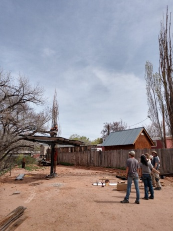 Interns working on the pole array for a homeowner who's home is too shaded for a roof install.